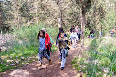 Group of Isaraeli fourth grade school kids. JERUSALEM - FEB. 11, 2017: Group of Isaraeli fourth grade school kids and their parents on a field trip in a forest Royalty Free Stock Photo