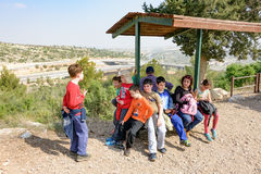 Group of Isaraeli fourth grade school kids. JERUSALEM - FEB. 11, 2017: Group of Isaraeli fourth grade school kids and their parents on a field trip in a forest Stock Image