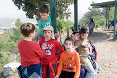 Group of Isaraeli fourth grade school kids and their parents. JERUSALEM - FEB. 11, 2017: Group of Isaraeli fourth grade school kids and their parents on a field Royalty Free Stock Photos