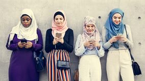 Group of islamic girls using smart phone royalty free stock photography