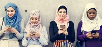 Group of islamic girls using smart phone stock image