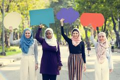 Group of islamic women holding speech bubbles stock photography