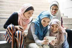 Group of islamic women looking at smartphone stock image