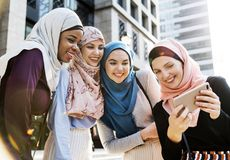 Group of islamic women taking selfie together royalty free stock photography