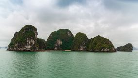 Group of islands with secret beach in ha long bay Vietnam stock photography
