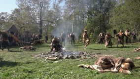Group Itelmens people dancing ritual dance near fire and scream in traditional clothing indigenous. Itelmens national