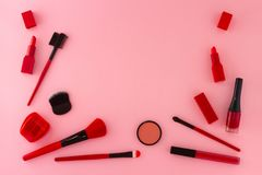 Group of items for make-up in red shades. stock photos