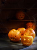 Group of Jack o Lanterns Carved from Oranges Stock Images