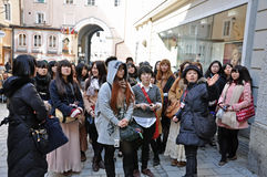 A group of Japanese tourists visits Salzburg Royalty Free Stock Photos