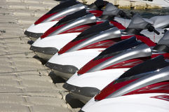 Group of Jet Skis on Dock Stock Photo