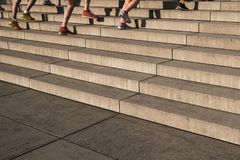 group of jogger running upwards stairs - outdoor fitness training royalty free stock photo