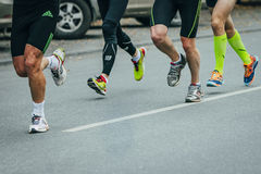 Group of joggers running down the street Royalty Free Stock Photography