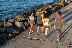 Group of joggers talking during workout Stock Image