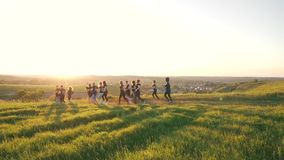 Group running outdoors in the sunlight