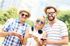 Group of joyful friends with smartphones Stock Images