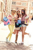 Group of joyful girl friends shopping in the city Royalty Free Stock Photo