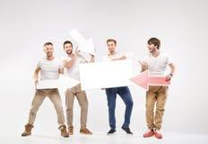 Group of joyful guys holding symbols Royalty Free Stock Image