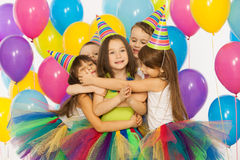 Group of joyful little kids having fun at birthday Royalty Free Stock Photography