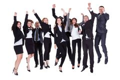 Group of jubilant business people. Jumping for joy and shouting in their excitement at their success isolated on white Royalty Free Stock Photo