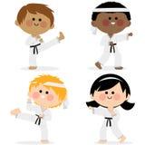 Group of karate kids wearing martial arts uniforms. Group of children wearing martial arts uniforms: karate, Taekwondo, judo, jujitsu, kickboxing, or kung fu Stock Photos