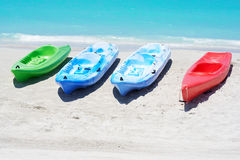 Group of kayaks in a beach. Group of kayaks ready to be rented in a beach Stock Photography