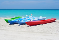Group of kayaks in a beach. Group of kayaks ready to be rented in a beach Royalty Free Stock Images