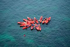 Group of Kayaks in formation in the ocean royalty free stock photos