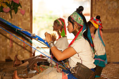 Group of Kayan Lahwi girl is weaving. Stock Photography