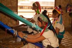 Group of Kayan Lahwi girl is weaving. Royalty Free Stock Photo