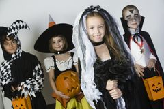 Group Of Kid In Halloween Costumes. Group portrait of cute little kids in Halloween costumes Stock Photo