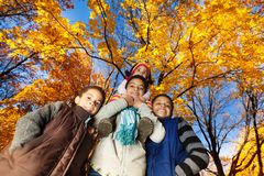 Group of kids in autumn park Royalty Free Stock Photo