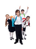 Group of kids with backpacks returning to school after vacation. Group of happy kids with backpacks returning to school after summer vacation Royalty Free Stock Photography