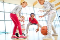 Group of kids at a basketball game. In elementary school physical education royalty free stock photos