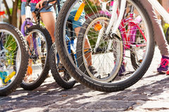 Group of kids bicycles standing on the road Royalty Free Stock Photography
