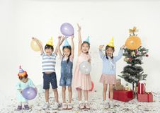 Group of kids celebrate christmas and happy new year party royalty free stock image