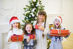 Group of kids with Christmas gifts Stock Photo