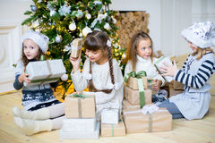 Group of kids with Christmas gifts Stock Images
