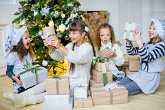 Group of kids with Christmas gifts Royalty Free Stock Image