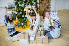 Group of kids with Christmas gifts Stock Photos