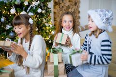Group of kids with Christmas gifts Royalty Free Stock Images