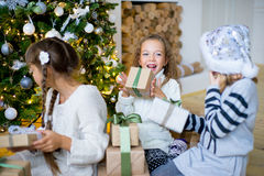 Group of kids with Christmas gifts Stock Image