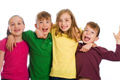 Group of kids with colorful shirts on. Royalty Free Stock Photography