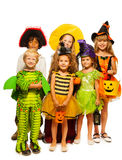 Group of kids in costumes isolated on white stock images