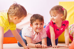 Group of kids crawl together and smile Royalty Free Stock Images
