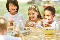 Group of kids is drinking milk and juice stock image