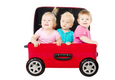 Group of kids driving in suitcase car. Shipping and innovation concept. Isolated white Royalty Free Stock Images