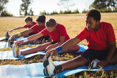 Group of kids exercising in the boot camp. On a sunny day royalty free stock photo