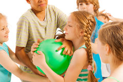 Group of kids fighting over the ball royalty free stock photography