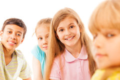 Group of kids with focus on smiling beautiful girl Royalty Free Stock Images