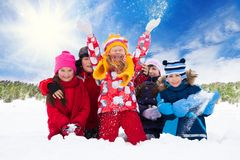 Group of kids and fun on snow day Stock Images